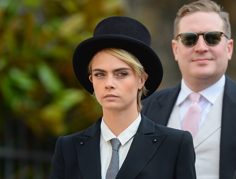 Cara Delevingne dons a menswear look for the wedding of Princess Eugenie of York and Jack Brooksbank.d.