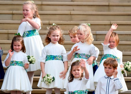 The bridesmaids and page boys wave off Britain's Princess Eugenie of York and her husband Jack Brooksbank from the West Steps of St George's Chapel.