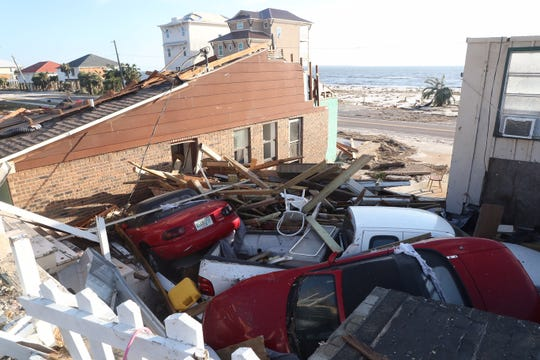 Cars piled up from Hurricane Michael are seen In Beacon Hill, Fla. on Thursday. It is next to Mexico City, Fla. It was landfall for Hurricane Michael.