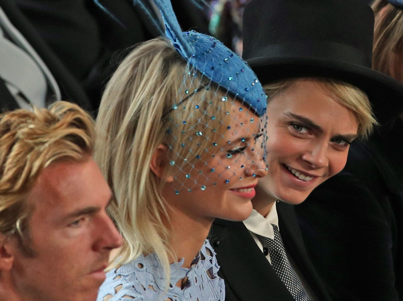 Poppy Delevinge center, and Cara Delevingne react during the wedding ceremony of Britain's Princess Eugenie of York.