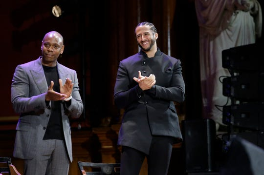 Comedian Dave Chappelle and Colin Kaepernick applaud during W.E.B. Du Bois Medal award ceremonies.