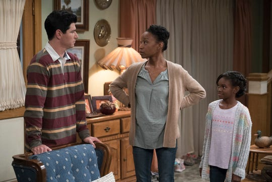 D.J. (Michael Fishman), left, talks to his wife, returning military veteran Geena (Maya Lynne Robinson), as their daughter Mary (Jayden Rey) listens on ABC's 'The Conners.'