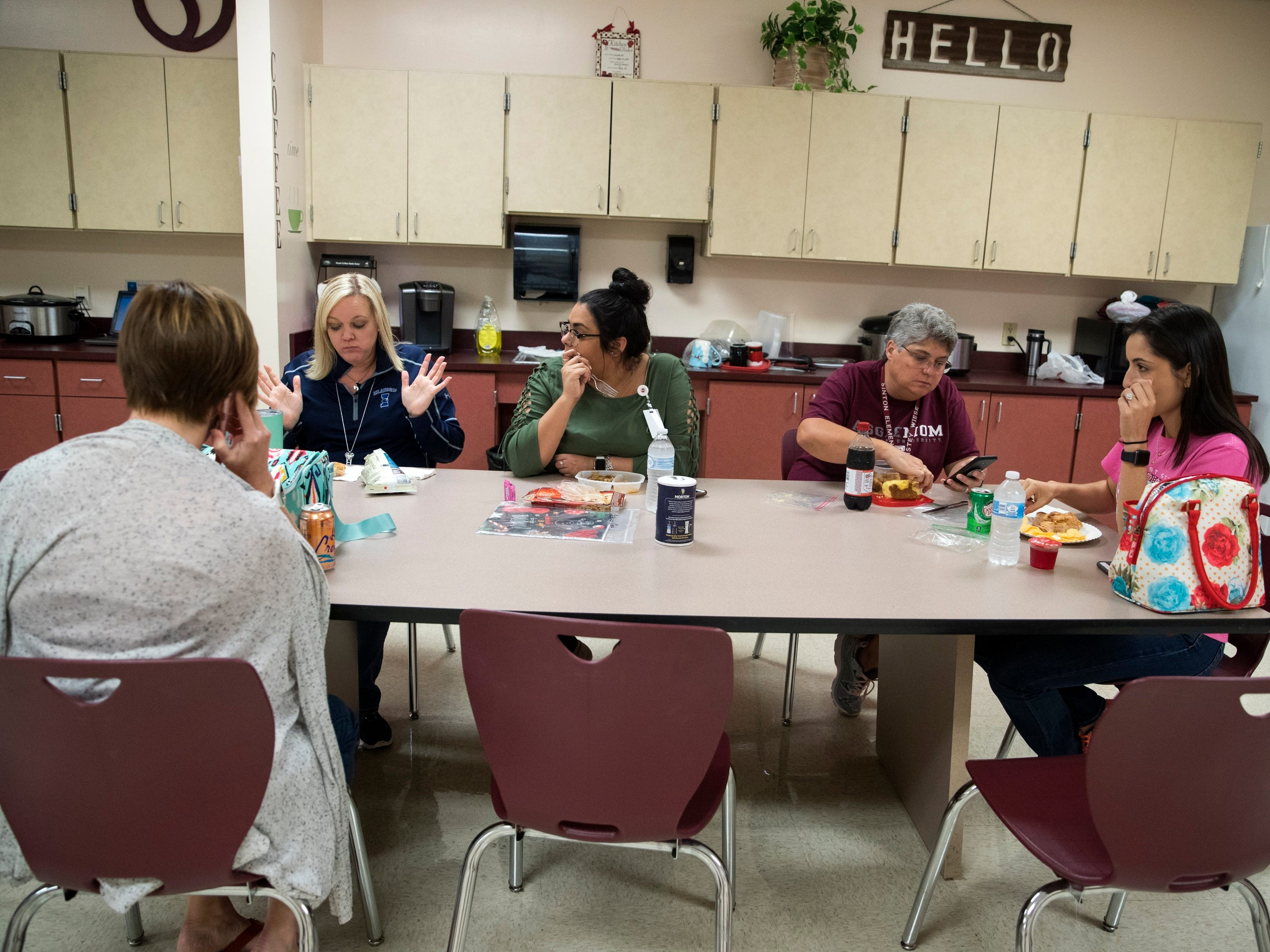 Sinton, TX – Christine McFarland, second from left, speaks with fellow teacher during her 30 minute lunch break.
