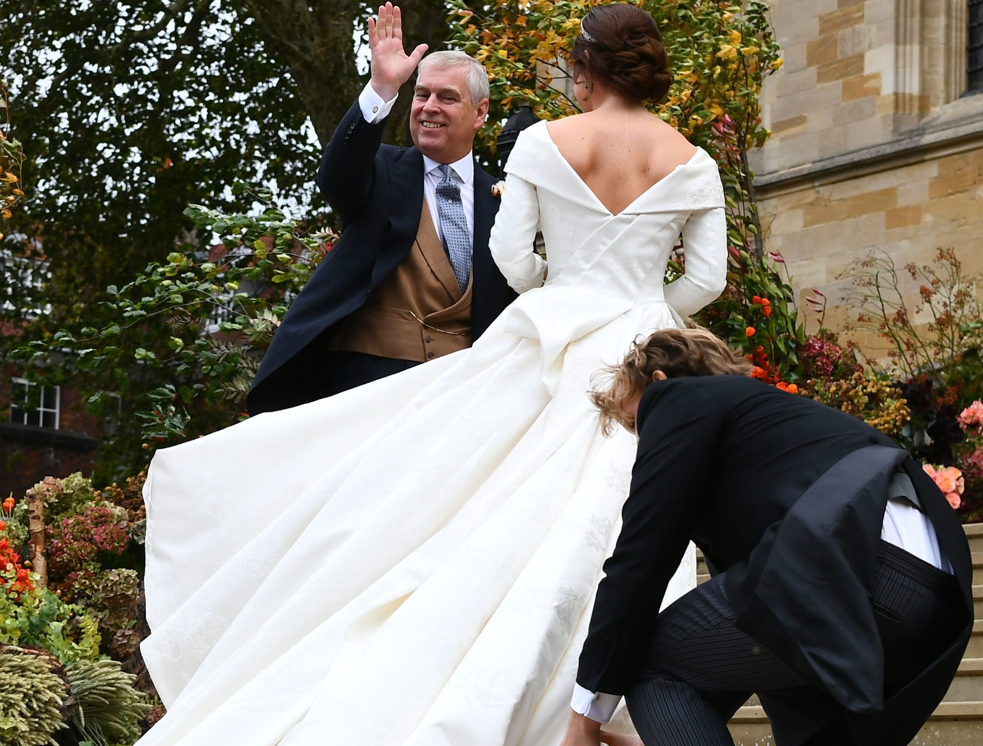 Britain's Princess Eugenie of York (R) arrives accompanied by her father Prince Andrew, Duke of York, (L) for her wedding to Jack Brooksbank at St George's Chapel, Windsor Castle, in Windsor, on October 12, 2018. (Photo by Victoria Jones / POOL / AFP)VICTORIA JONES/AFP/Getty Images ORIG FILE ID: AFP_19Y9VE