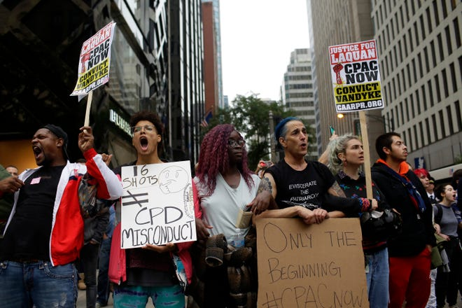 Demonstrators protest as they celebrate the guilty verdict in the Jason Van Dyke murder trial on October 5, 2018 in Chicago.