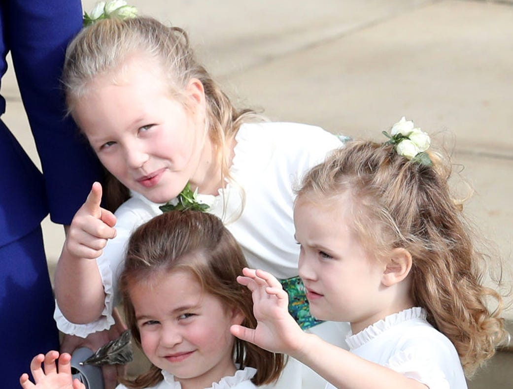 Bridesmaids Princess Charlotte of Cambridge, Savannah Phillips and Maud Windsor wave off Princess Eugenie of York and Mr. Jack Brooksbank.