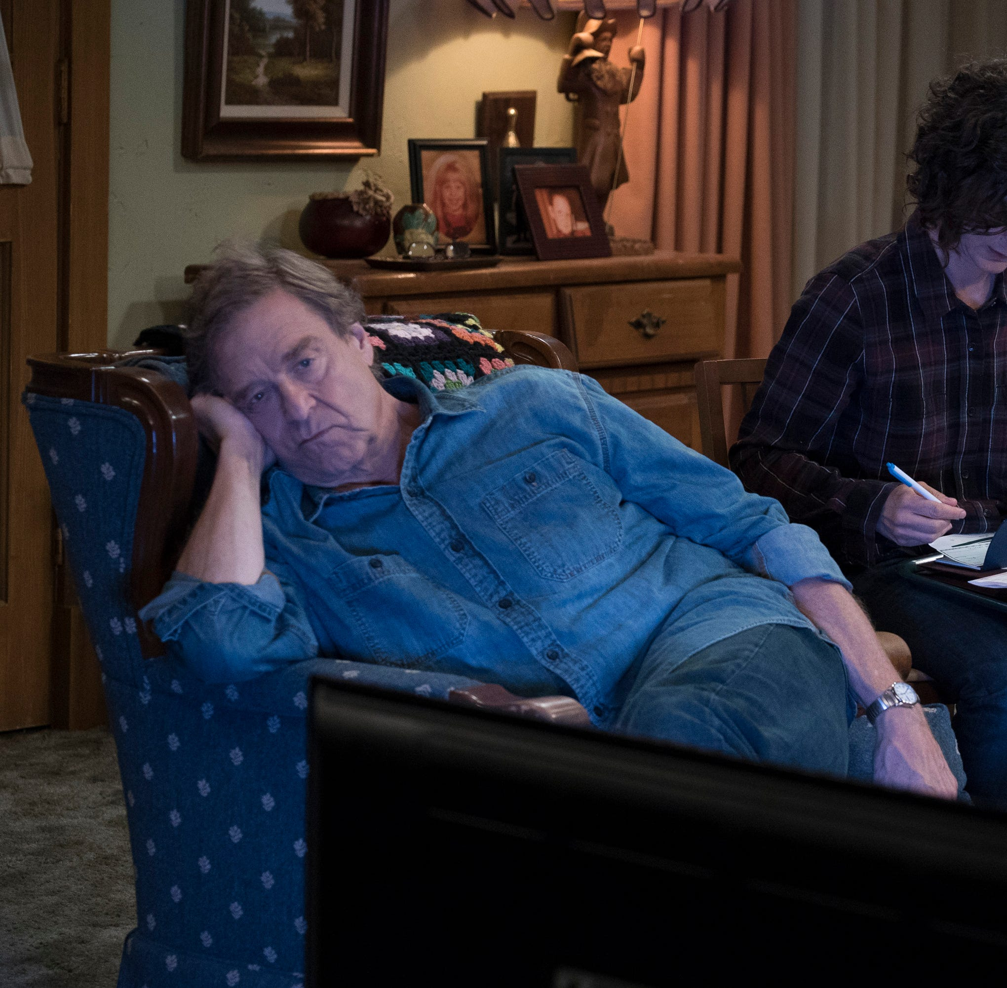 A saddened Dan (John Goodman), left, and a busy, bill-paying Darlene (Sara Gilbert) must hold the family together in the absence of matriarch Roseanne on ABC's 'The Conners.'