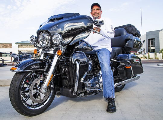 Bill Davidson, the great grandson of William Davidson, one of four original founders of Harley-Davidson Motorcycles, sits atop his Harley in Scottsdale, Arizona, Wednesday, August 22, 2018.  Davidson and other Harley enthusiasts stopped in Scottsdale during their San Diego to Milwaukee cross country ride to commemorate Harley's 115th anniversary.  There will be a big party in Milwaukee Aug. 29-Sept. 2. (Via OlyDrop)