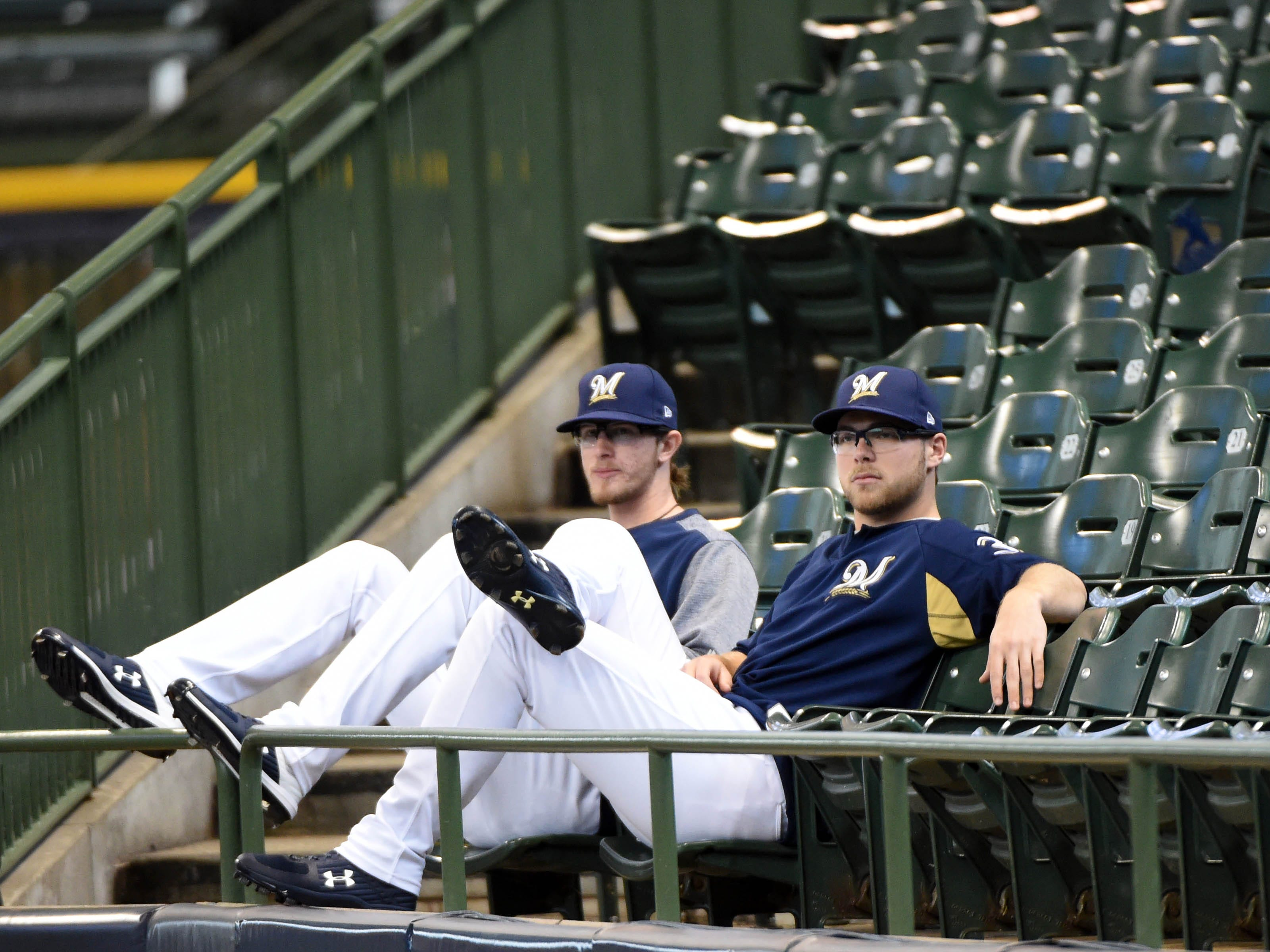 NLCS Game 1: Brewers relief pitcher Josh Hader and starter Corbin Burnes relax in the stands.