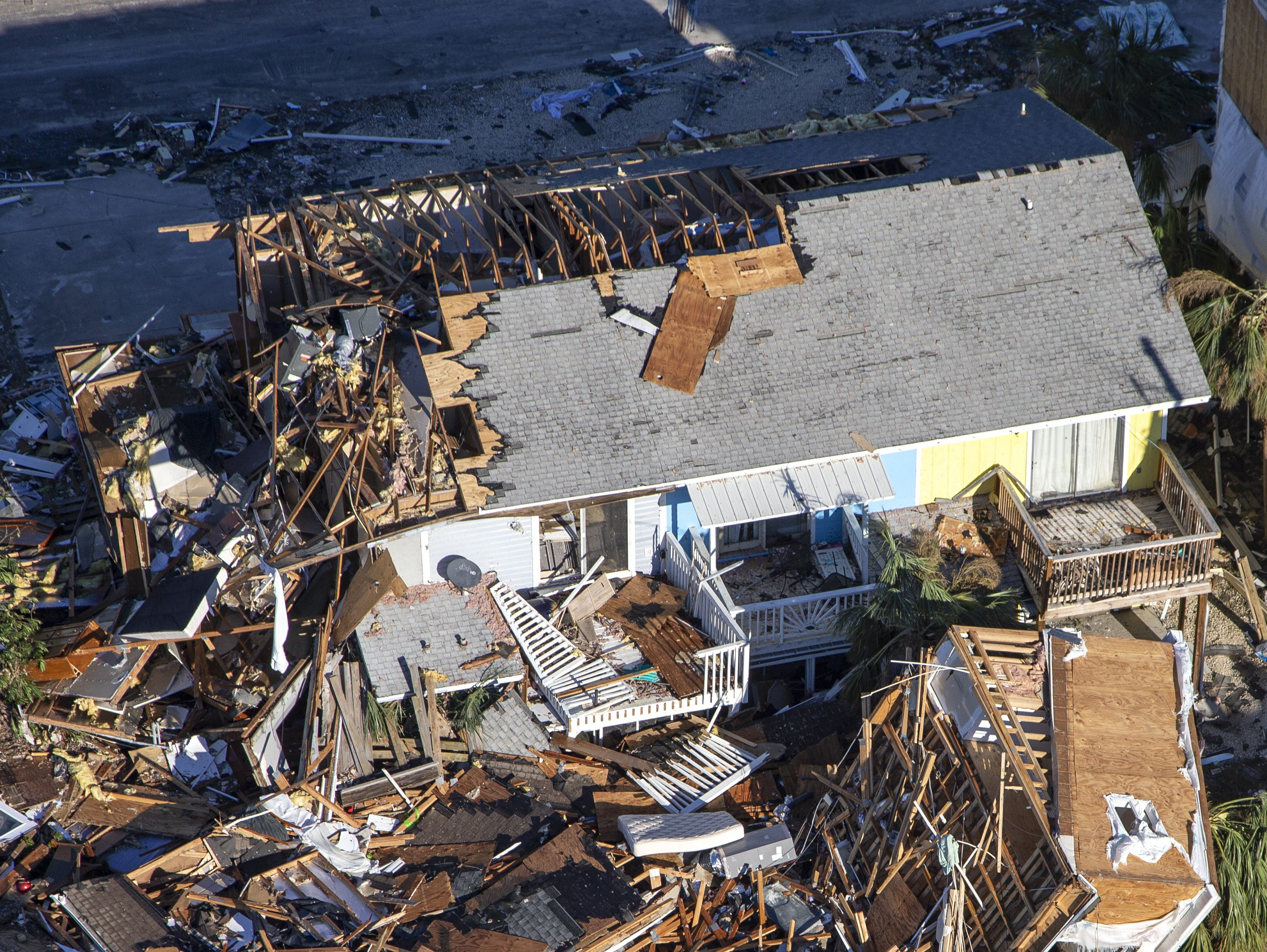 MEXICO BEACH, FL - OCTOBER 12: Homes and businesses along US 98 are left in devastation by Hurricane Michael on October 12, 2018 in Mexico Beach, Florida. At least 13 people have died across the South since Hurricane Michael made landfall along the Florida Panhandle Wednesday as a Category 4 storm.