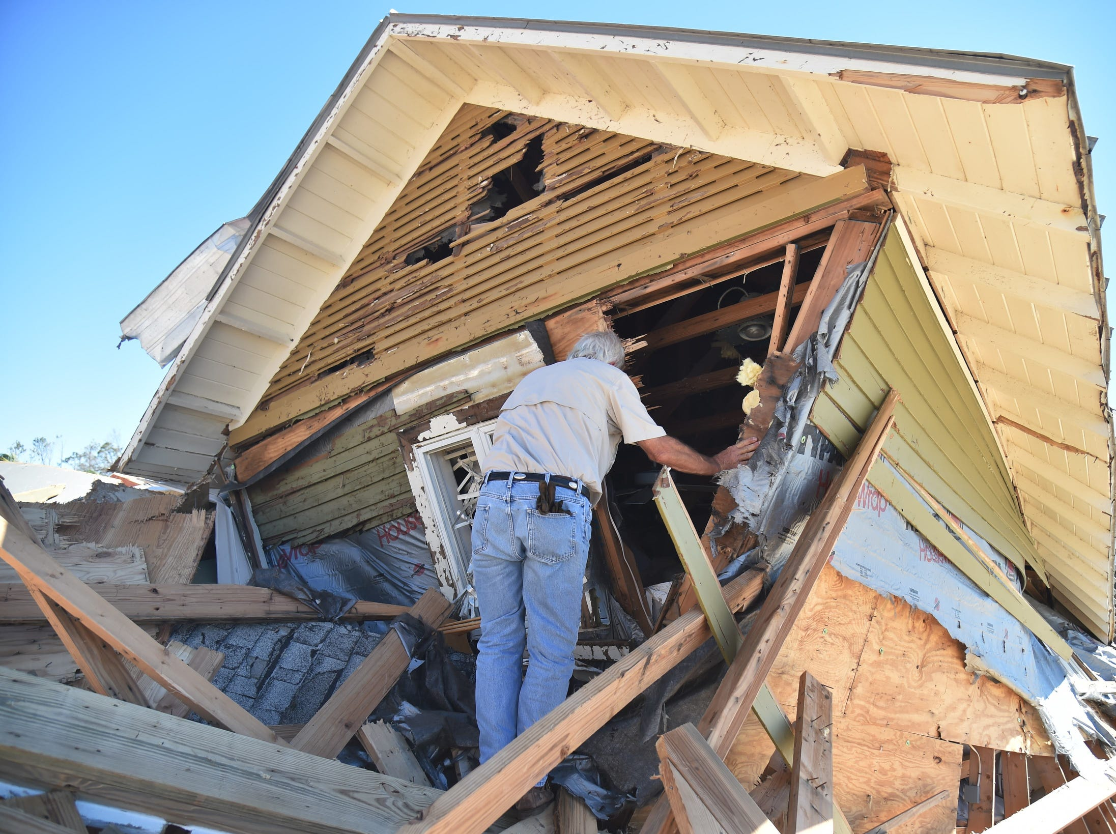 Pete Miller checks the remains of his house in the aftermath of Hurricane Michael on  in Mexico Beach, Fla.  Rescue teams using sniffer dogs carried out a grim search for victims of Hurricane Michael on Friday amid fears that the death toll from the monster storm, which currently stands at 11, could rise.