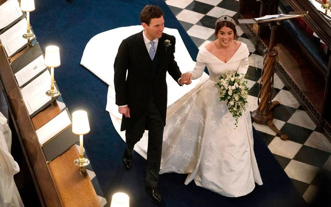 Princess Eugenie of York and Jack Brooksbank walk back down the aisle after their wedding ceremony at St George's Chapel, Windsor Castle, in Windsor, on Oct.12, 2018.