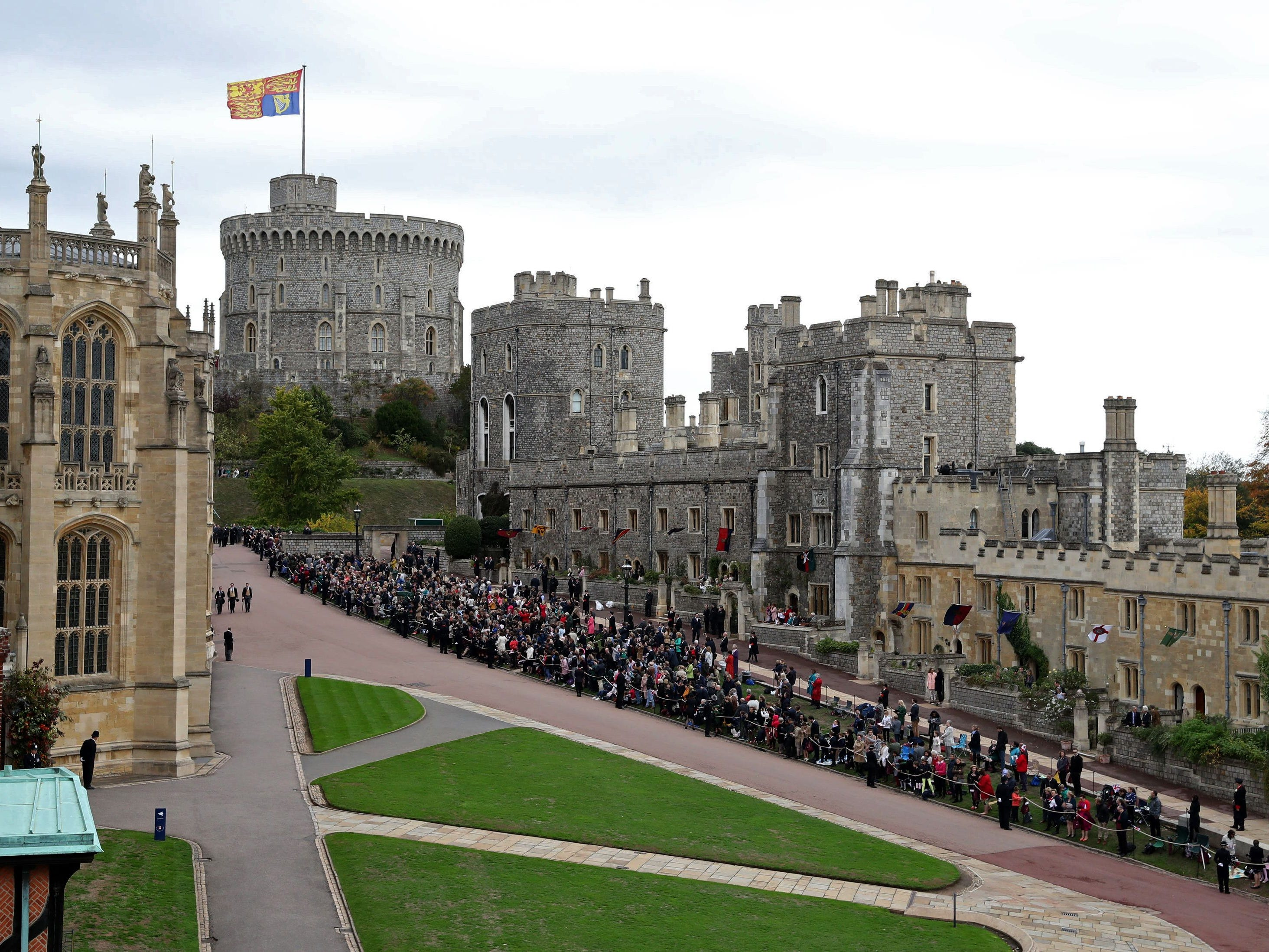 Royal well-wishers wait to see the wedding procession of Britain's Princess Eugenie of York and her new husband Jack Brooksbank at Windsor Castle.