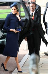 Duchess Meghan's suit coat from Princess Eugenie's royal wedding Friday further fueled pregnancy rumors.