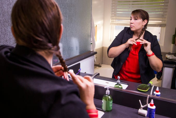 Phoenix, AZ –Rebecca Garelli brushes her hair at 6:41 am before heading out for her hour-long drive to Sevilla West Elementary School in Phoenix, Arizona, on September 17. Garelli has been a leader of the RedForEd movement, which demands increased funding for Arizona public schools.
