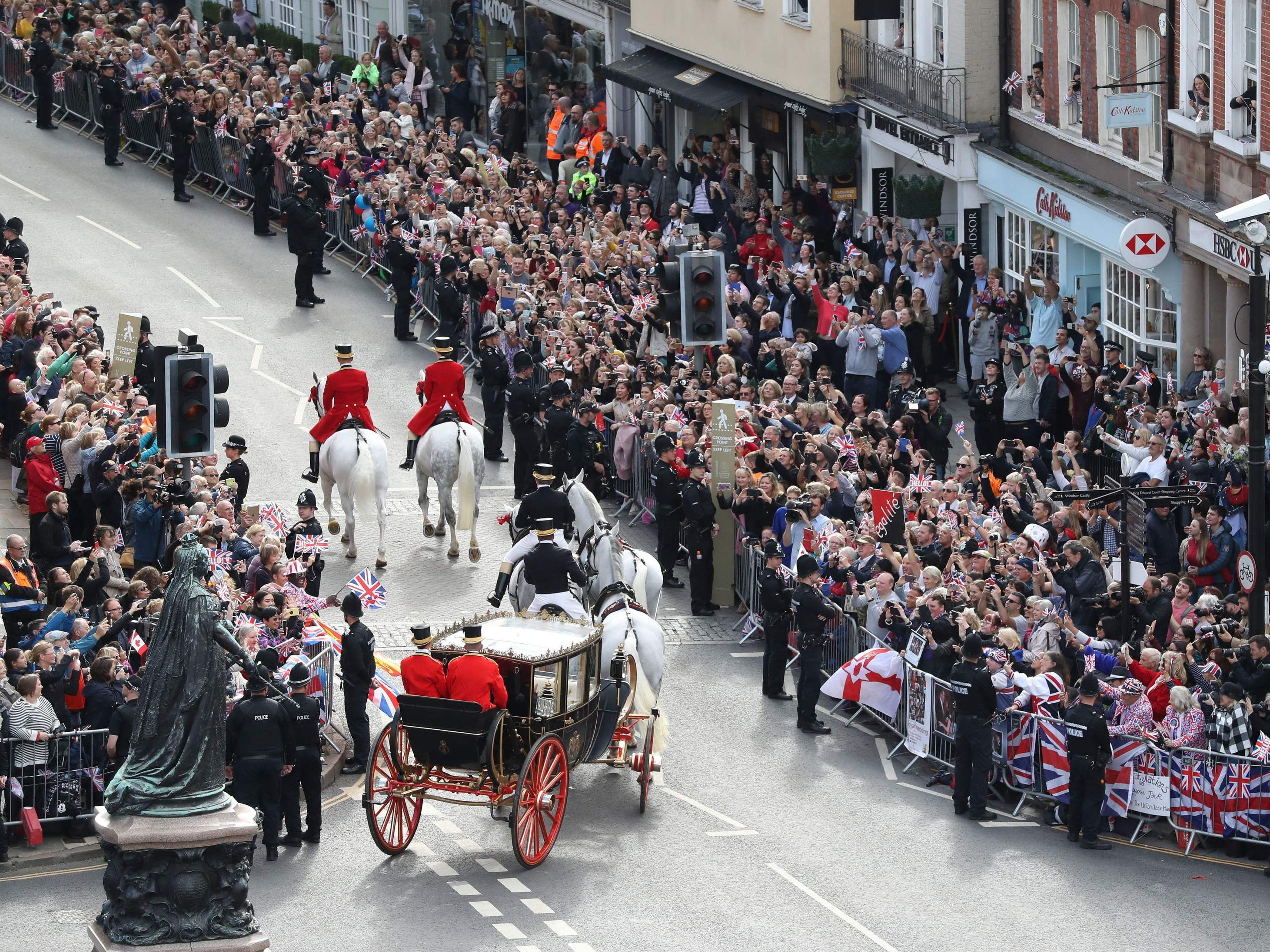 Britain's Princess Eugenie of York and her husband Jack Brooksbank travel in the Scottish State Coach at the start of their carriage procession following their wedding.