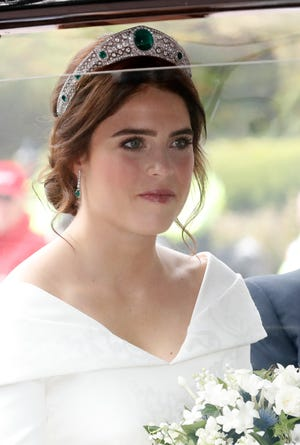 Princess Eugenie of York arrives by car for her Royal wedding to Mr. Jack Brooksbank at St. George's Chapel on Oct. 12, 2018 in Windsor, England.