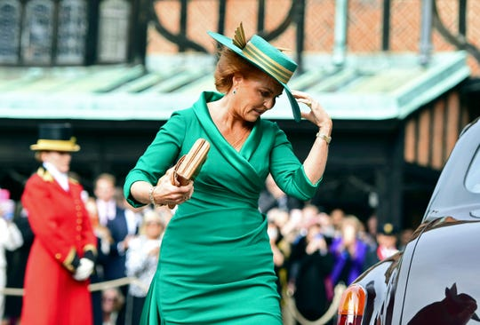 Eugenie's mother, Sarah Ferguson (formerly the Duchess of York) had to hold her hat on as she entered St. George's Chapel.
