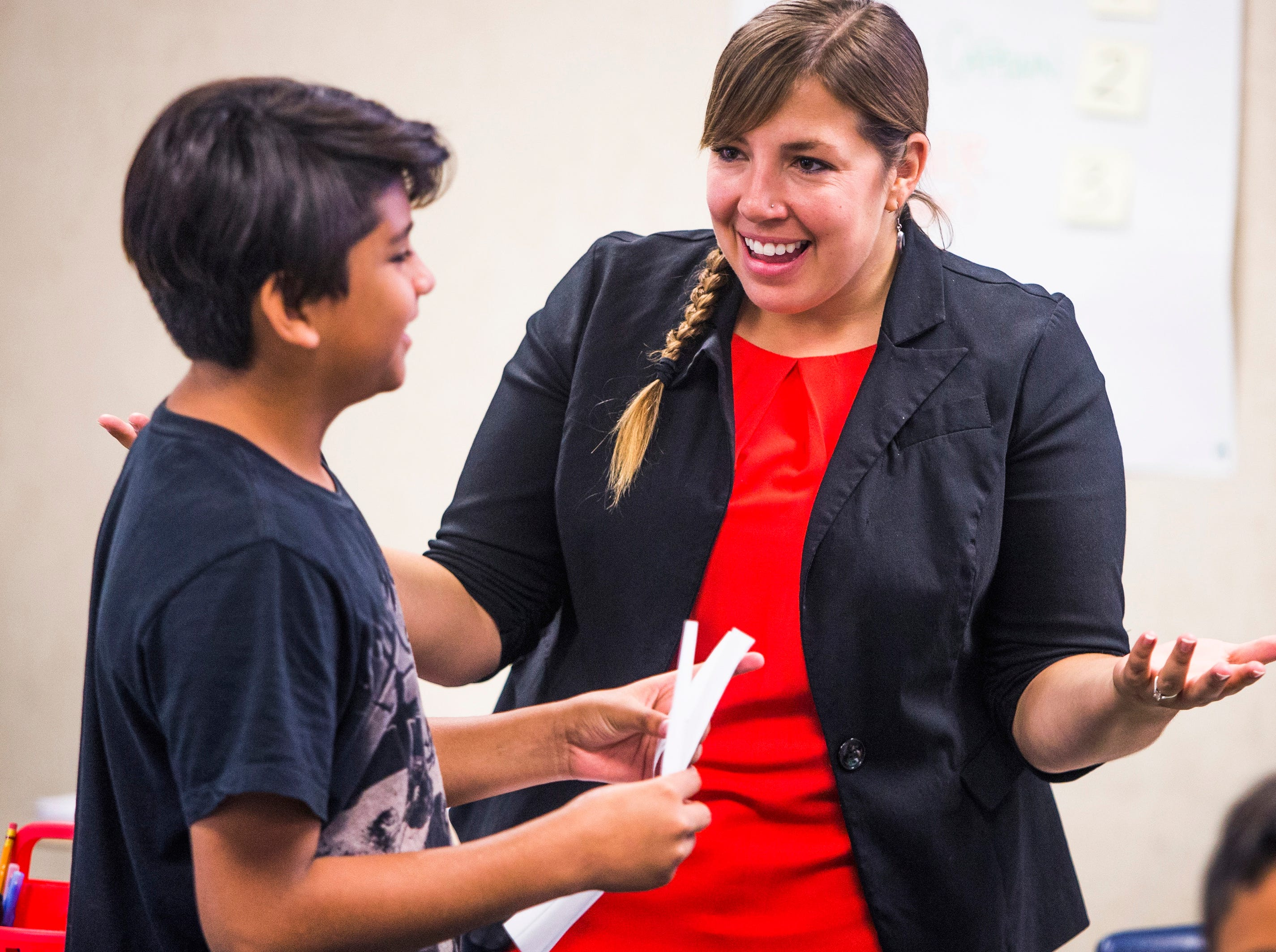 Phoenix, AZ – Rebecca Garelli speaks with Giovanni Romero Rodriguez, 11, during 6th grade science class at Sevilla West Elementary School.