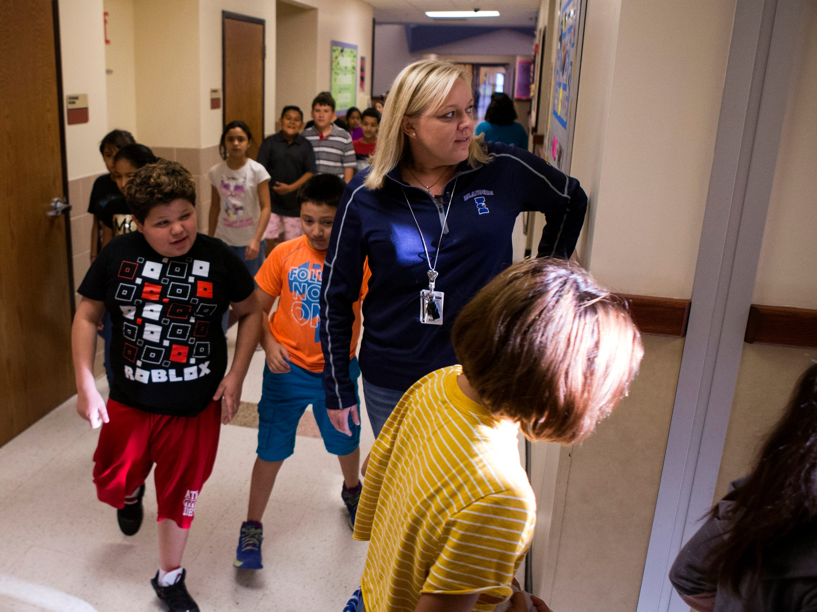 "Sinton, TX – Christine McFarland, a fifth-grade teacher at Sinton Elementary School, drops her class off at PE before heading to to planning meeting. ""I wish I had more time to plan lessons that were more engaging for students,"" she said. ""I feel like we work real hard to find good lessons but then we find that we run out of time."""