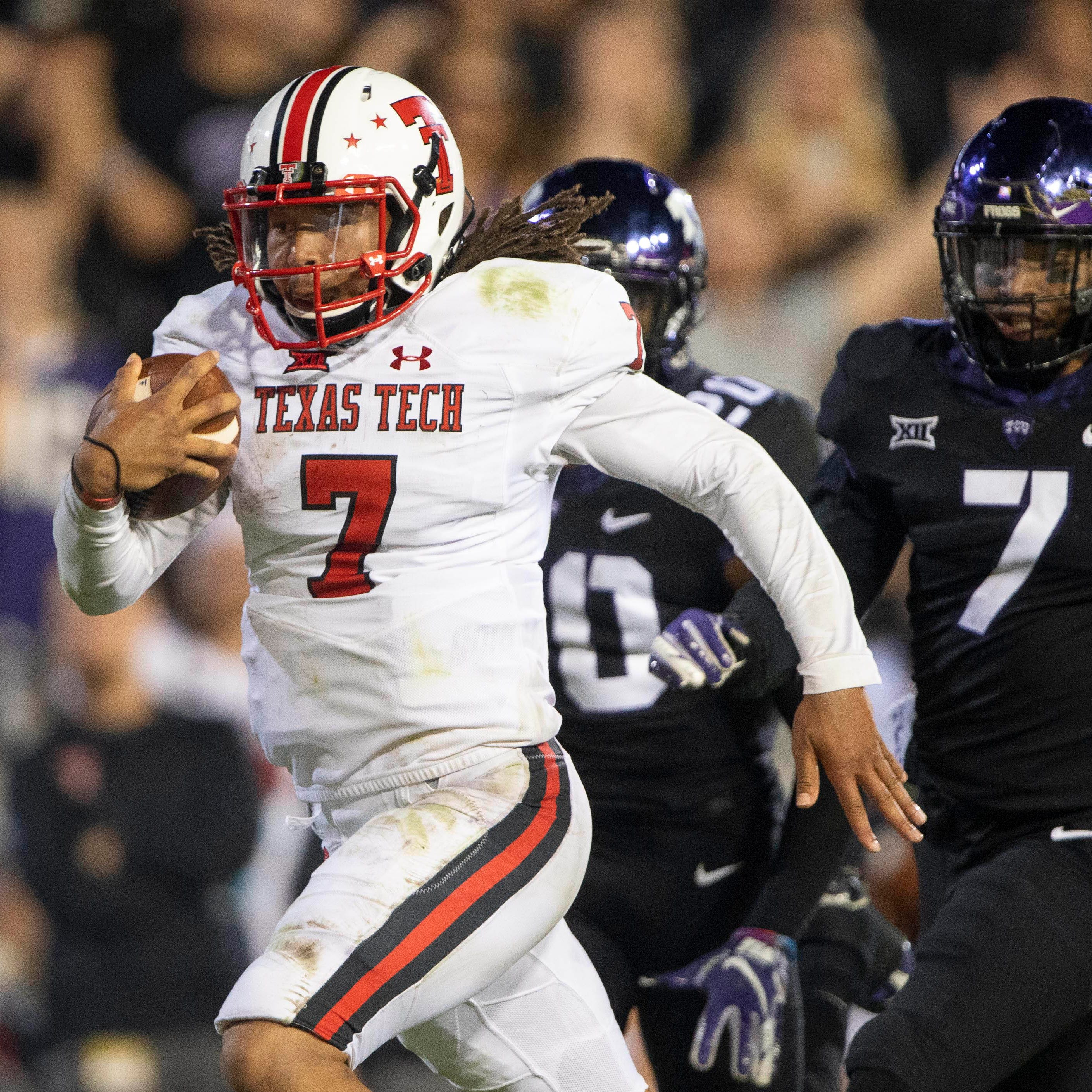 Texas Tech quarterback Jett Duffey scores the game-winning touchdown against TCU.