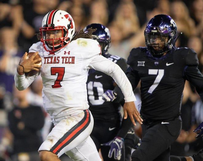 Texas Tech quarterback Jett Duffey scores the game-winning touchdown against TCU.