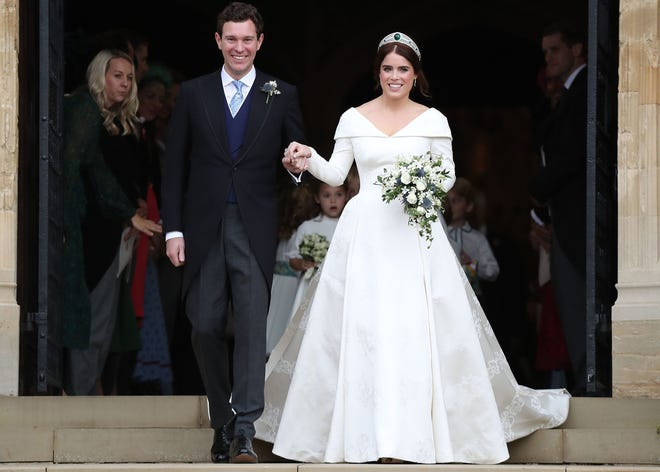 Princess Eugenie of York and her new husband Jack Brooksbank emerge from St George's Chapel, Windsor Castle, in Windsor, on Oct. 12, 2018 after their wedding.