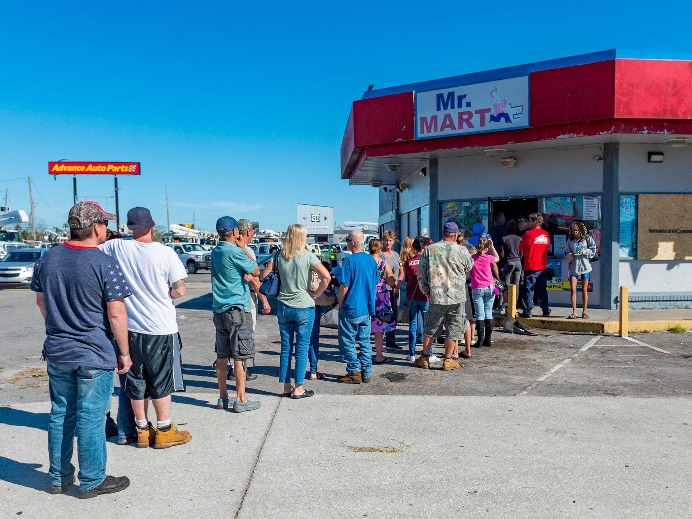 Long lines waiting for supplies in Panama City, Fla. Friday, Oct. 12, 2018.