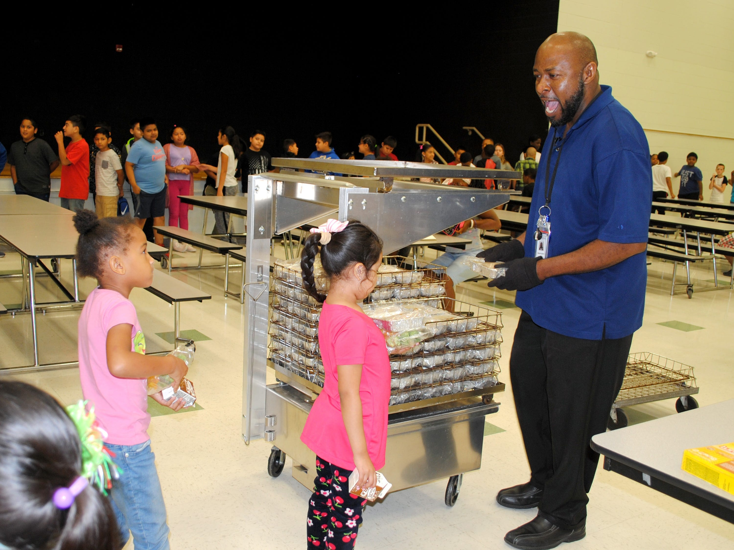 Racine WI – Edward Lawson hands out lunches to students. As a home substitute in the school Lawson fills in where he's needed at the school.