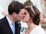 Princess Eugenie of York and Jack Brooksbank kiss as they leave St George's Chapel in Windsor Castle following their wedding.