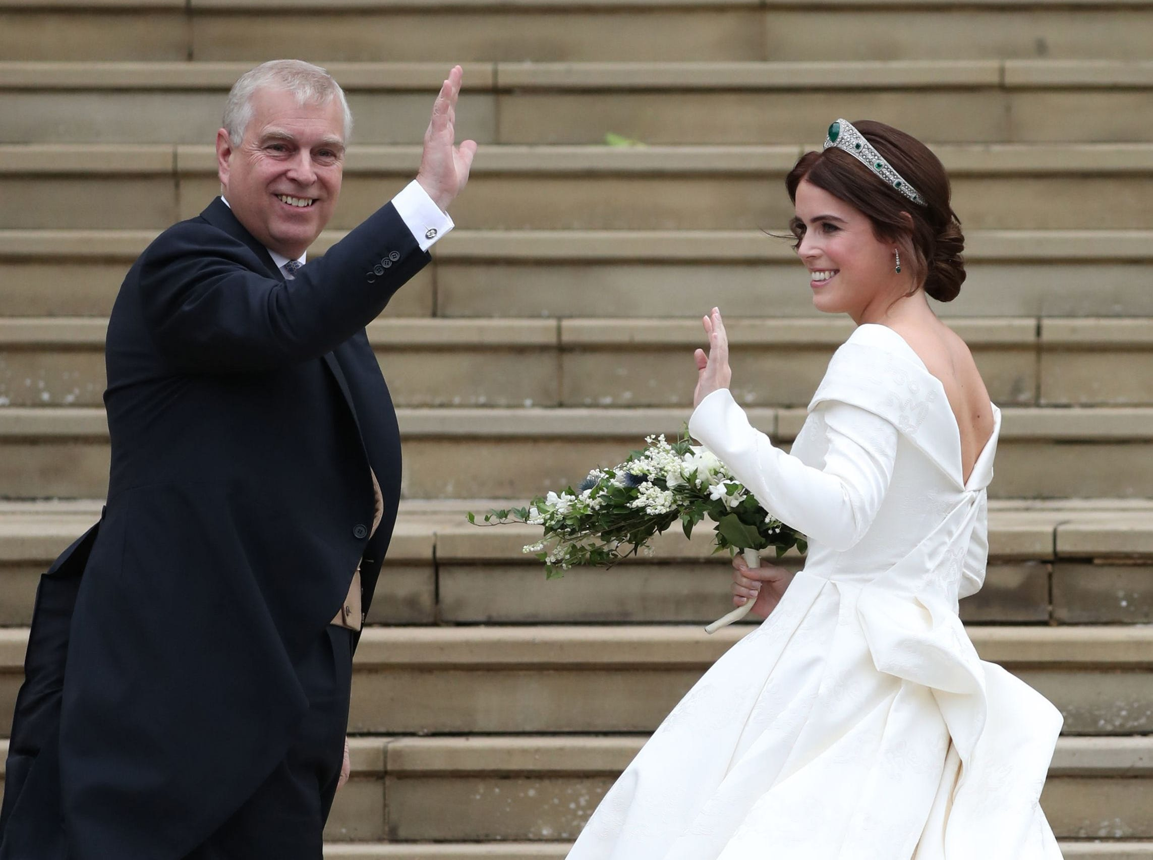 Britain's Princess Eugenie of York (R) arrives accompanied by her father Prince Andrew, Duke of York, (L) for her wedding to Jack Brooksbank at St George's Chapel, Windsor Castle, in Windsor, on October 12, 2018. (Photo by Steve Parsons / POOL / AFP)STEVE PARSONS/AFP/Getty Images ORIG FILE ID: AFP_19Y9TV