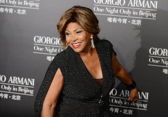 Tina Turner arrives on the red carpet for a  fashion show by Giorgio Armani in Beijing on May 31, 2012.