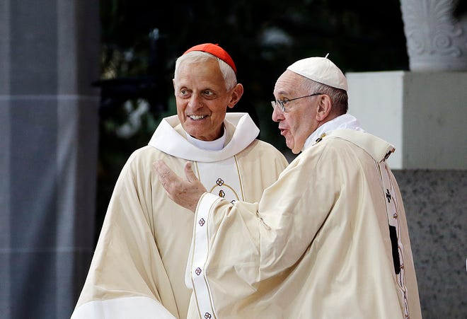 This Wednesday, Sept. 23, 2015 file photo shows Cardinal Donald Wuerl, archbishop of Washington, left, talking with Pope Francis after a Mass in the Basilica of the National Shrine of the Immaculate Conception  in Washington.