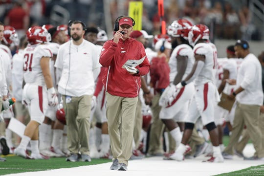 Arkansas coach Chad Morris walks on the sidelines during his team's game against Texas A&M at AT&T Stadium.