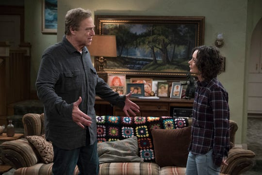 "Dan Conner (John Goodman), left, and his daughter, Darlene (Sara Gilbert) in ""The Conners."""