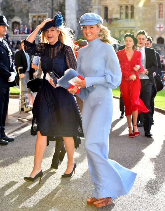 Chelsy Davy, left, arrives for the wedding of Princess Eugenie of York and Jack Brooksbank at St George's Chapel, Windsor Castle, near London, England, Friday Oct. 12, 2018.