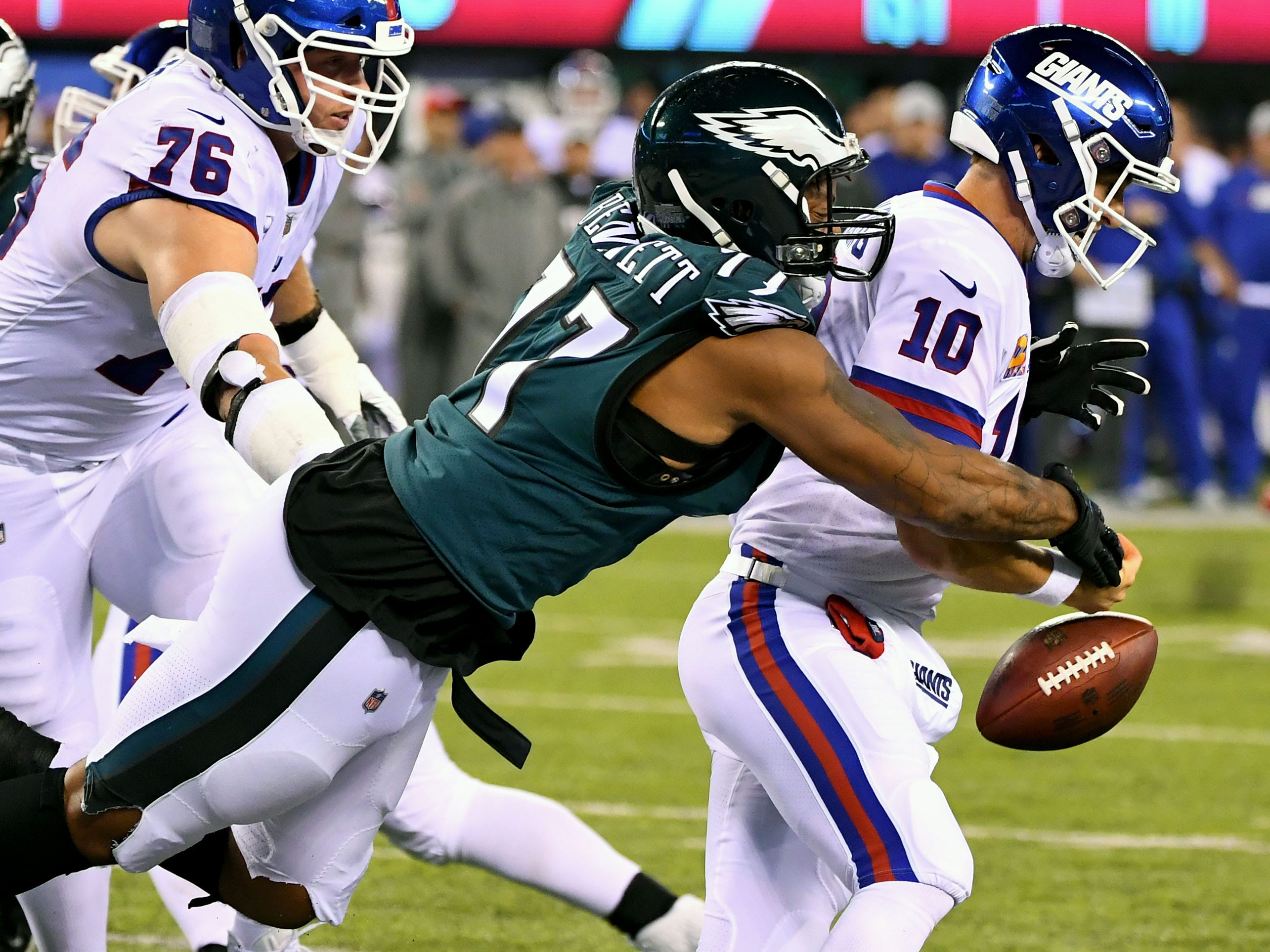 Philadelphia Eagles defensive end Michael Bennett hits New York Giants quarterback Eli Manning on the goal line forcing a fumble in the first quarter at MetLife Stadium. The Giants recovered the ball.