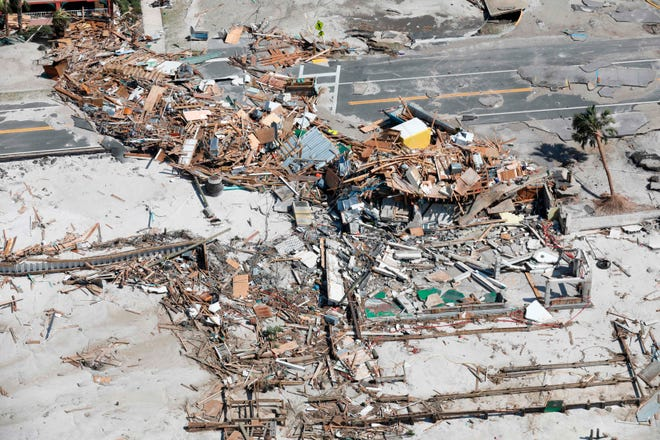 In this image released by US Customs and Border Protection, a CBP flight crew conducts a flyover of the Florida panhandle in the aftermath of Hurricane Michael as the storm left a swath of destruction across the area near Panama City, Florida, on October 11, 2018.