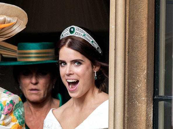 Princess Eugenie of York watched by her mother Sarah Ferguson reacts as she leaves Windsor Castle, Friday, after her wedding to Jack Brooksbank for an evening reception at the Royal Lodge.