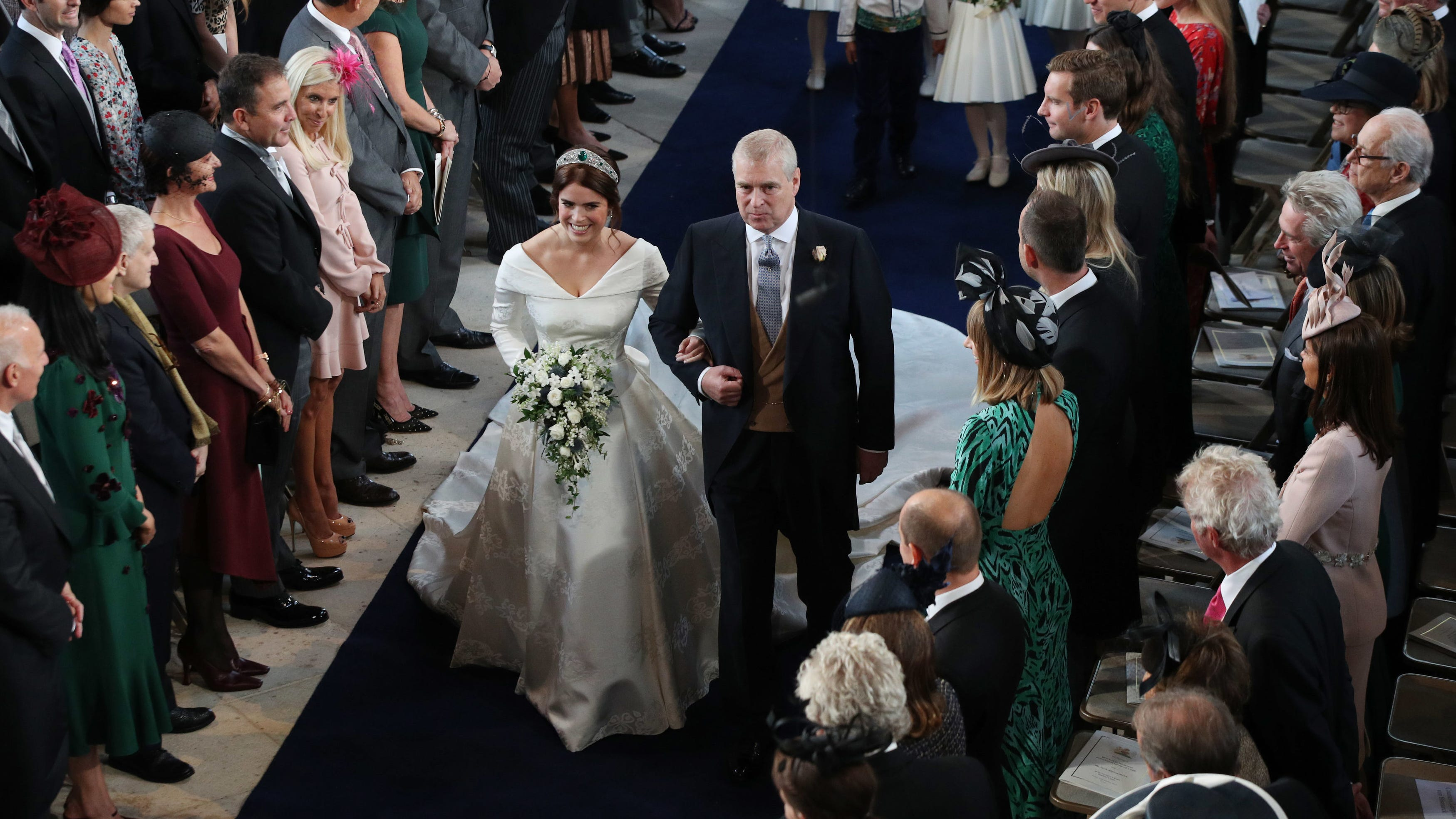 Britain's Princess Eugenie of York accompanied by...