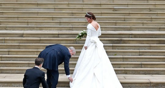 Princess Eugenie, accompanied by her father Prince Andrew, arrives for her wedding to Jack Brooksbank on steps of  St George's Chapel, Windsor Castle, Oct. 12, 2018.