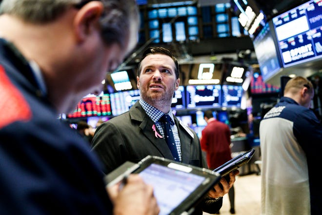 Traders work on the floor of the New York Stock Exchange in New York on Oct. 11, 2018.