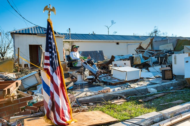 William Gay takes a break while helping a friend to find personal belongings in barber shop in Panama City, Fla after  Hurricane Michael caused widespread damage. Oct. 12, 2018.
