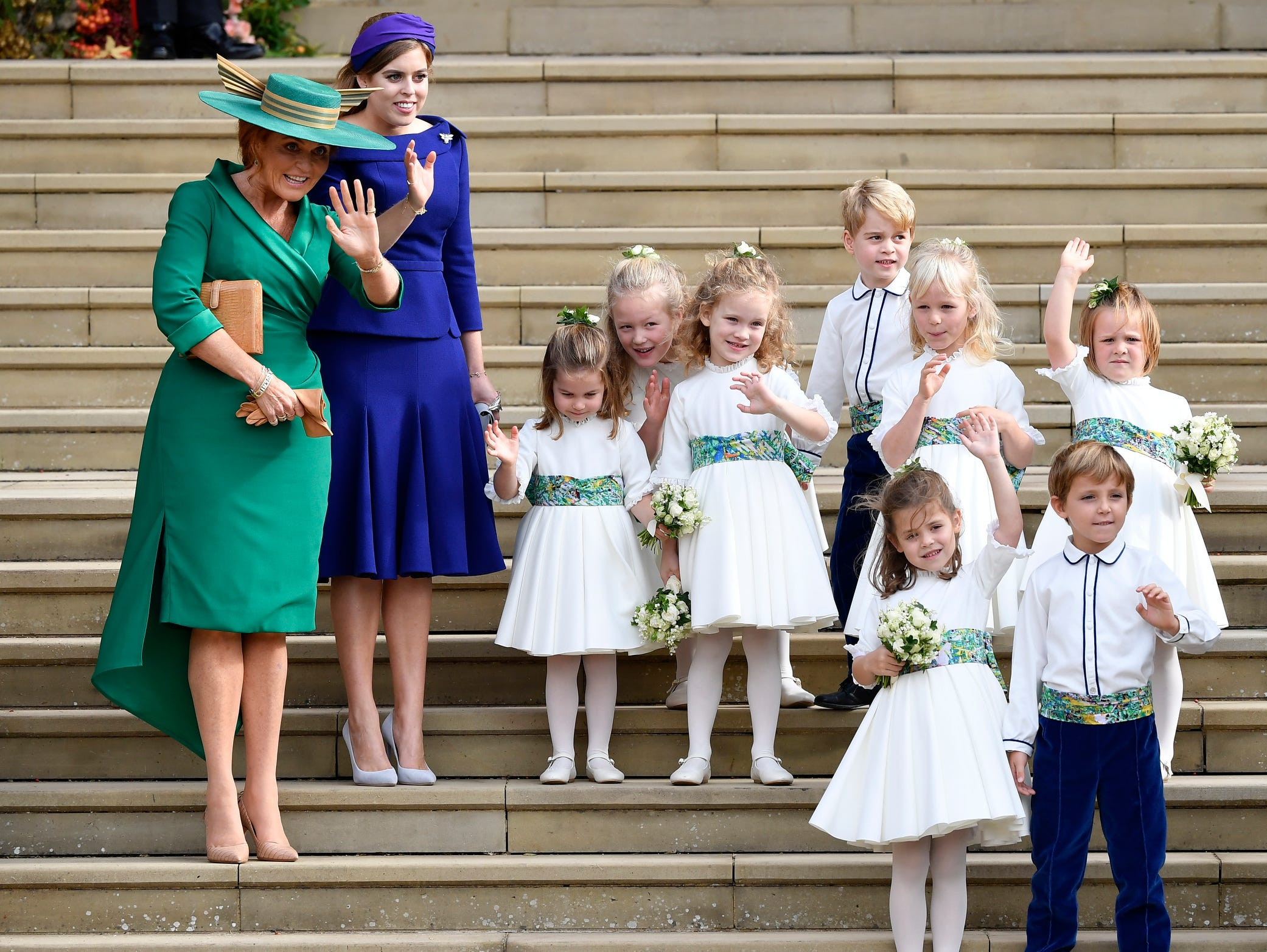 Sarah Ferguson, left her daughter Princess Beatrice, the bridesmaids and page boys, including Prince George and Princess Charlotte, wave after the wedding of Princess Eugenie of York and Jack Brooksbank, Friday.
