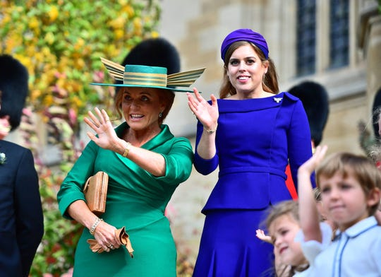 Sarah Ferguson, Duchess of York and Princess Beatrice of York at the wedding of Princess Eugenie of York with Jack Brooksbank in the Chapel of St. George on October 12, 2018 in Windsor.