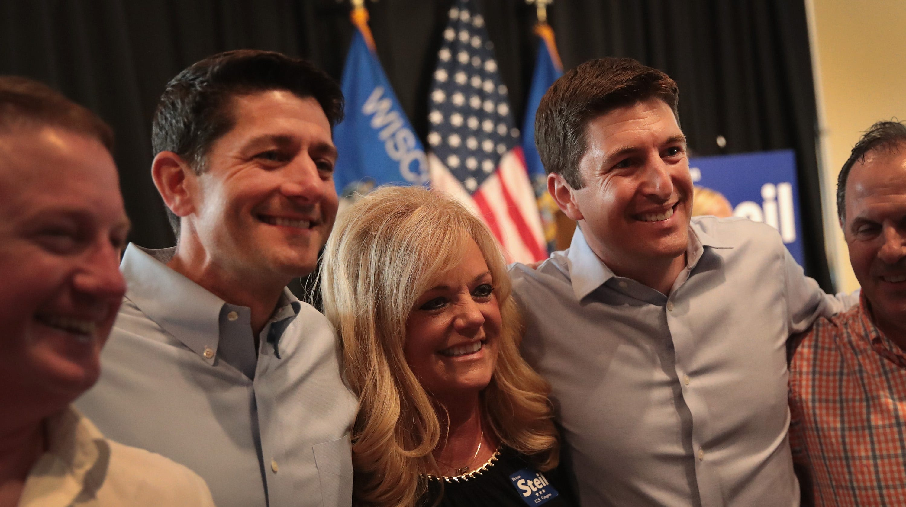Speaker of the House Paul Ryan (2nd from L) campaigns with Republican congressional candidate Bryan Steil (2nd from R) at a rally on August 13, 2018 in Burlington, Wis. Ryan will return to Wisconsin to campaign for Steil and others just before election day.