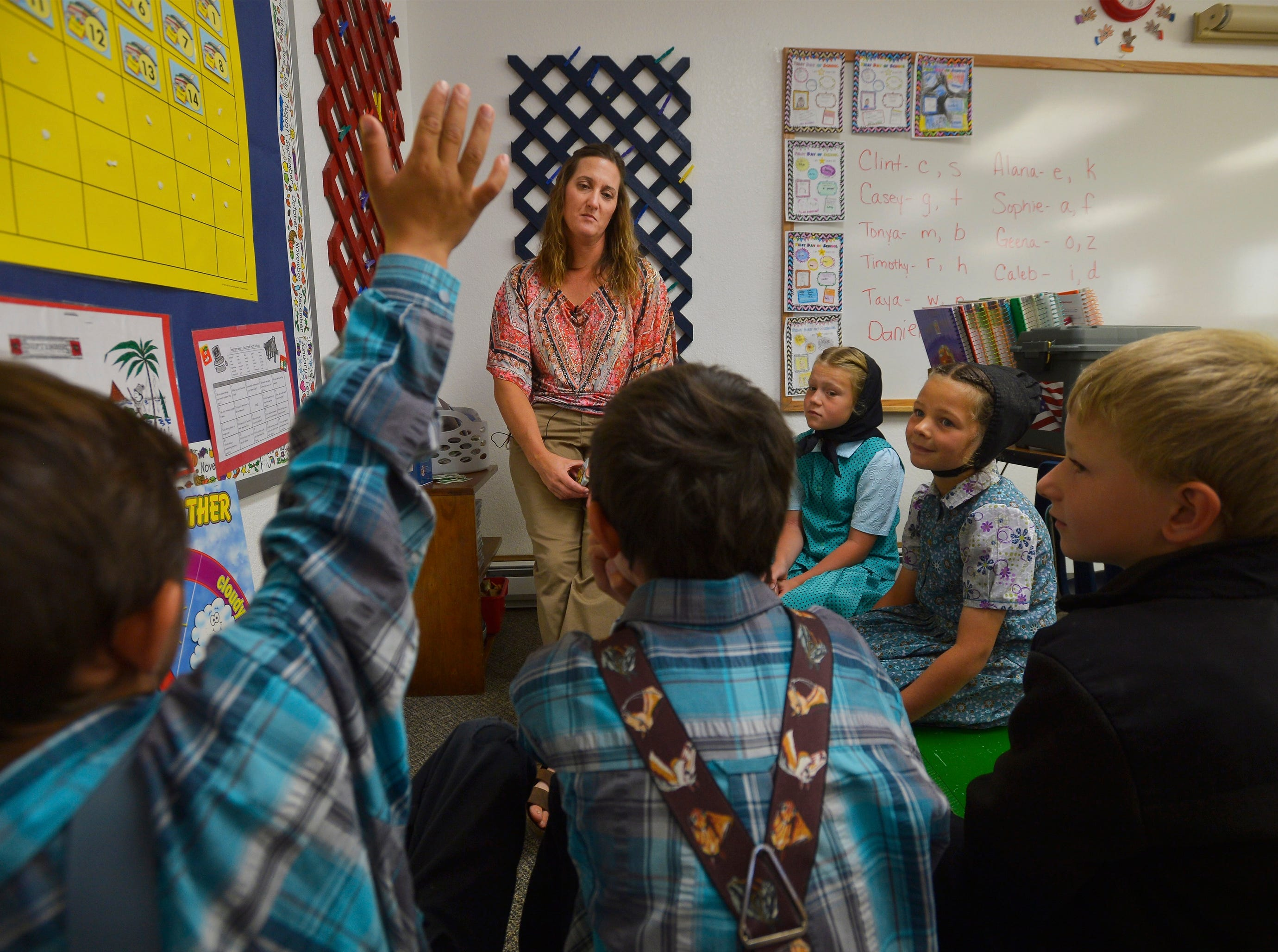 Deerfield, MT – Traci Manseau leads her younger students in a lesson on days of the week.