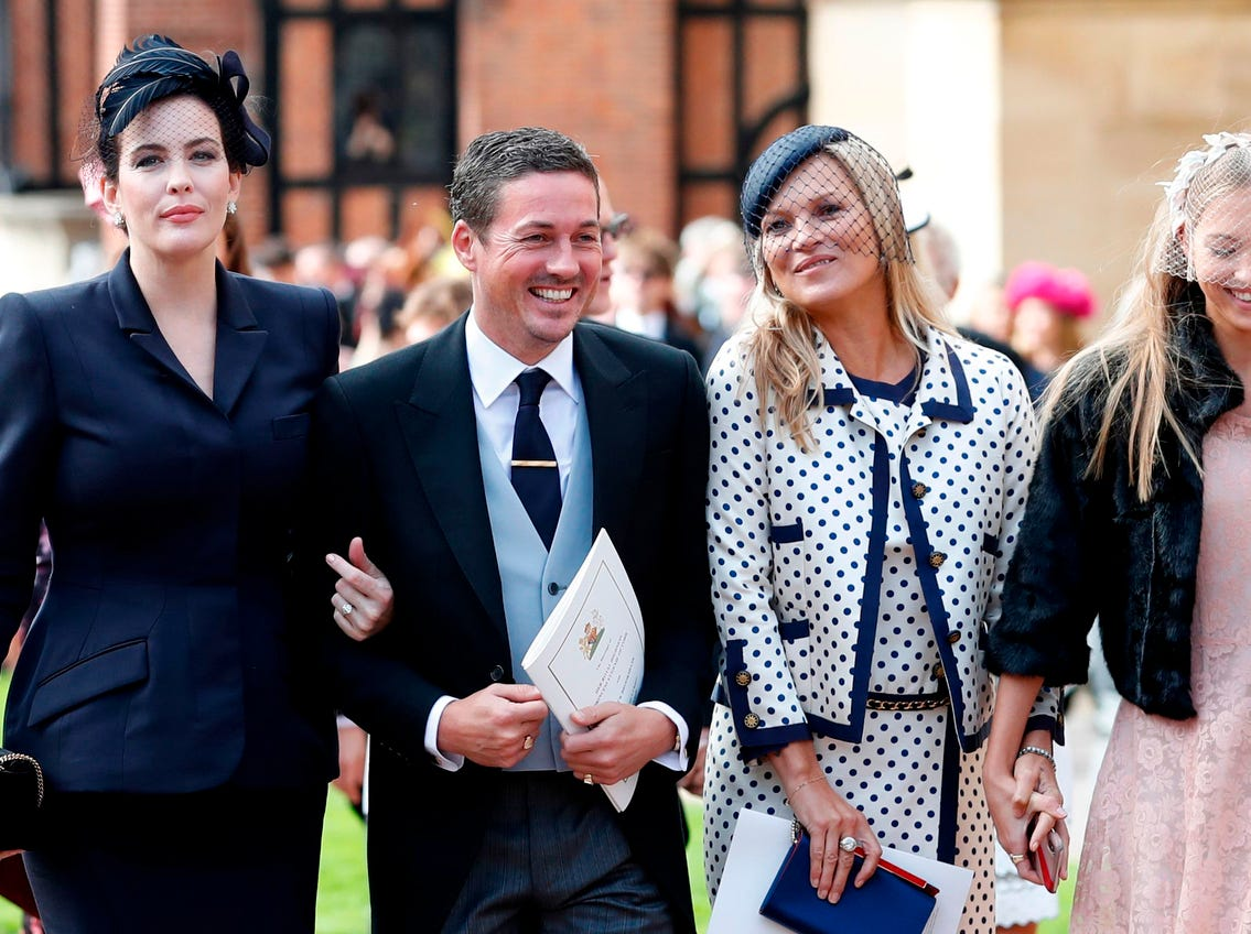 US actress Liv Tyler, left, and her partner Dave Gardner, model Kate Moss (2R) and her daughter Lila Grace Moss Hack attend the wedding of Britain's Princess Eugenie of York to Jack Brooksbank.