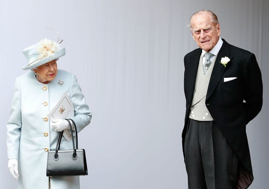 Queen Elizabeth II and her husband, Prince Philip, Duke of Edinburgh, at the wedding of his granddaughter, Princess Eugenie of York, with his Jack Brooksbank, in the chapel of St. George, in Windsor Castle, in Windsor, on October 12, 2018.