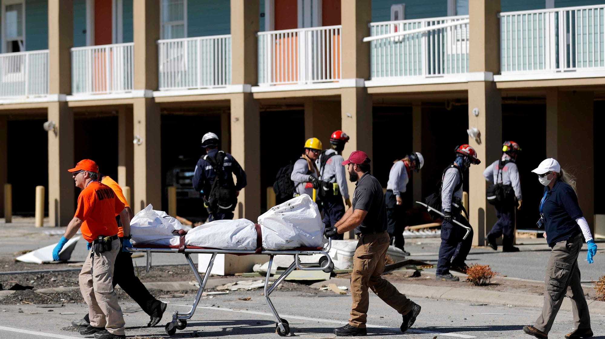 A body is removed after being discovered during the search of a housing structure in the aftermath of Hurricane Michael in Mexico Beach, Fla., Friday.